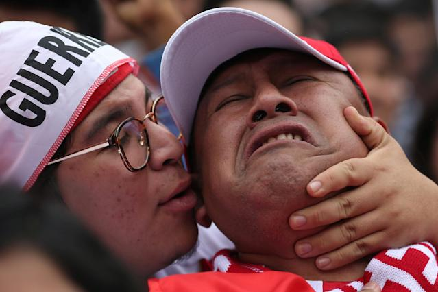 Soccer Football - World Cup - Group C - Peru vs Denmark - Lima, Peru June 16, 2018. Peru's fans react during the match as they watch the public broadcast at city's square. REUTERS/Guadalupe Pardo TPX IMAGES OF THE DAY