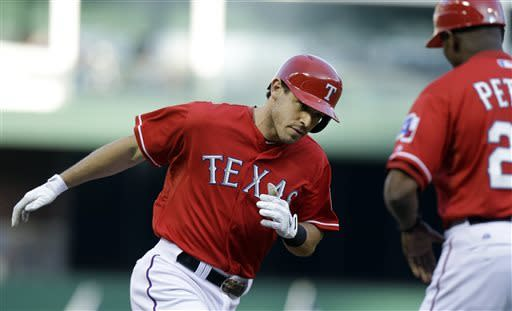 Texas Rangers Ian Kinsler (5) rounds the bases after a solo home run during the first inning of a baseball game against the Texas Rangers Saturday, May 4, 2013, in Arlington, Texas. (AP Photo/LM Otero)