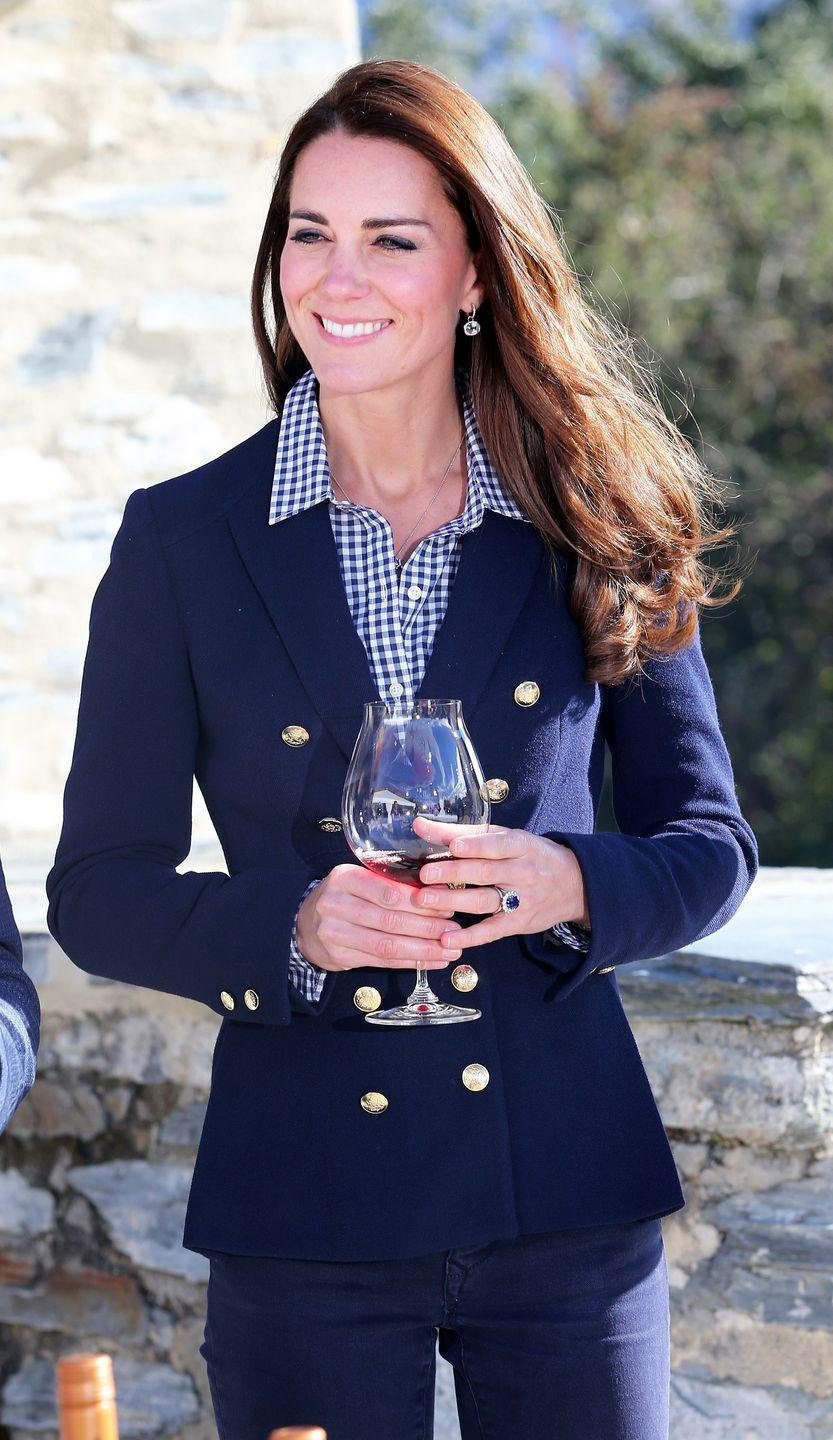<p>Kate Middleton made a 2014 visit to New Zealand wearing a gingham button down paired with her go-to double breasted navy blazer. </p>