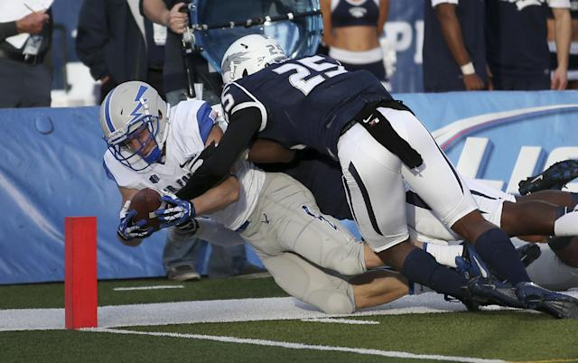Air Force's Anthony LaCoste (37) dives into Nevada's end zone during the first half of an NCAA college football game in Reno, Nev., on Saturday, Sept. 28, 2013. (AP Photo/Cathleen Allison)