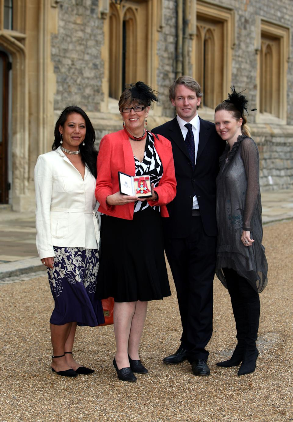 Prue Leith (2nd-L), with daughter Li-Da Kruger (L), her son Danny Kruger and his wife Emma pose after she became a Commander of the British Empire (CBE) at Windsor Castle on October 5, 2010 in Windsor, England. (Photo by Steve Parsons - WPA Pool/Getty Images)