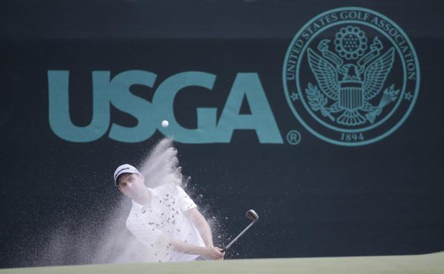 Brendon Todd hits out of the bunker on the 11th hole during the second round of the U.S. Open golf tournament in Pinehurst, N.C., Friday, June 13, 2014. (AP Photo/David Goldman)