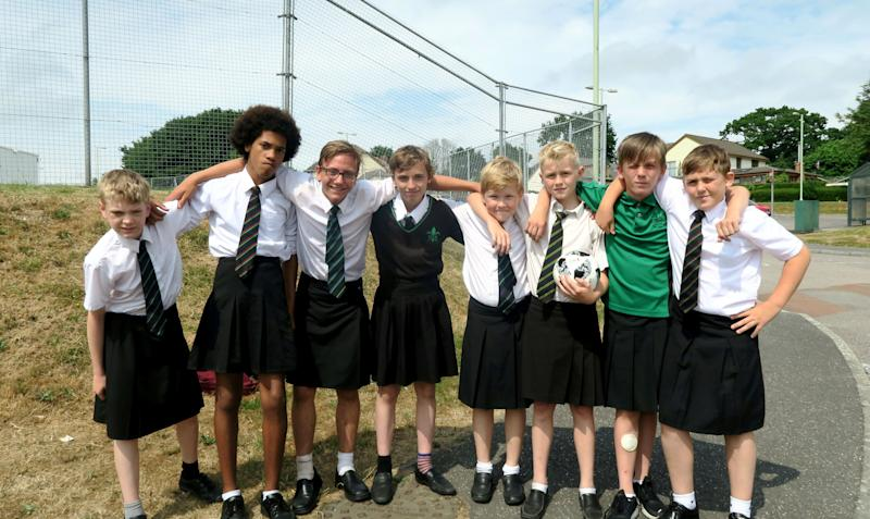 The boys from Great Torrington School, in Devon who wore skirts in protest at the school's no shorts policy. [Photo: SWNS]