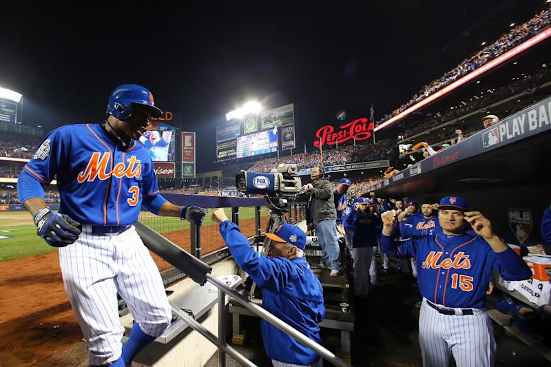 NEW YORK, NY - NOVEMBER 01: Curtis Granderson #3 of the New York Mets is greeted by manager Terry Collins #10 of the New York Mets in the dugout after hitting a solo home run in the first inning against the Kansas City Royals during Game Five of the 2015 World Series at Citi Field on November 1, 2015 in the Flushing neighborhood of the Queens borough of New York City. Elsa/Getty Images/AFP (AFP Photo/Elsa)