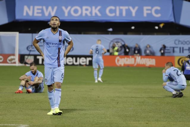 New York City FC's Alexander Callens, front left, reacts with teammates after an MLS Eastern Conference semifinal soccer match against Toronto FC on Wednesday, Oct. 23, 2019, in New York. Toronto won 2-1. (AP Photo/Frank Franklin II)