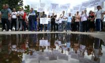 Citizens who support construction of hydroelectric power plants protest as environmentalists hold press conference in Sarajevo
