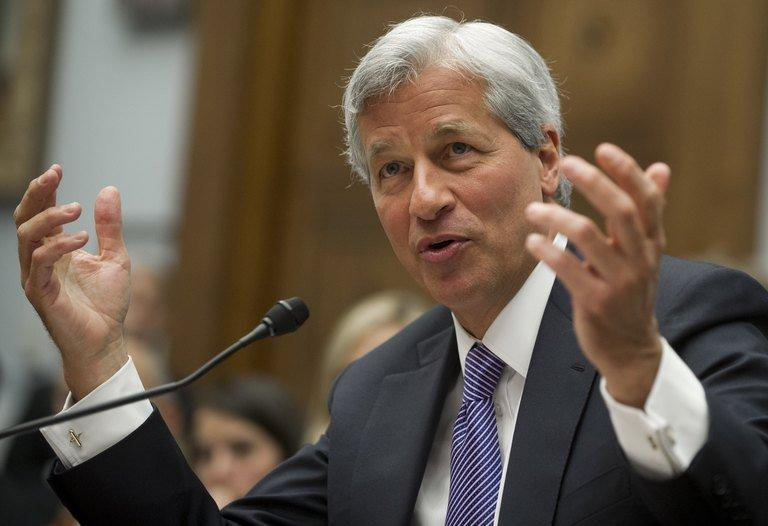 JPMorgan Chase Chairman and CEO Jamie Dimon testifies on Capitol Hill in Washington, DC on June 19, 2012. The firm's board of directors approved an unchanged annual salary of $1.5 million for Dimon and cut his bonus to $10 million, compared with $21.5 million for 2011