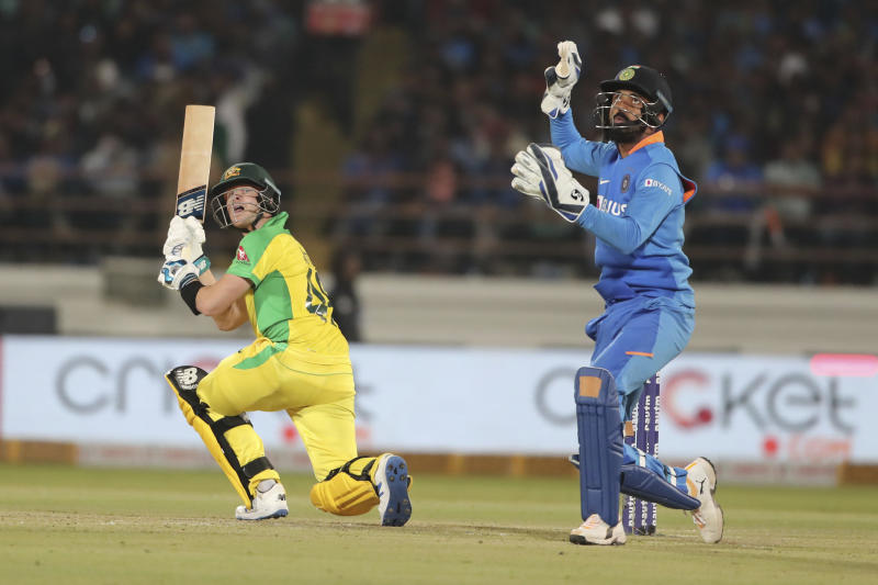 Australia's Steve Smith plays a shot during the second one-day international cricket match between India and Australia in Rajkot, India, Friday, Jan. 17, 2020. (AP Photo/Ajit Solanki)
