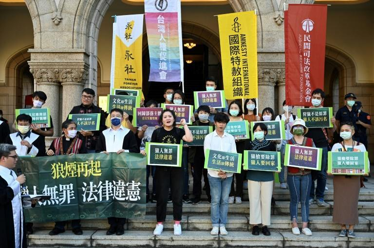 Protesters chanted slogans after a ruling on whether current hunting limitations placed on Taiwan's Indigenous communities are unconstitutional