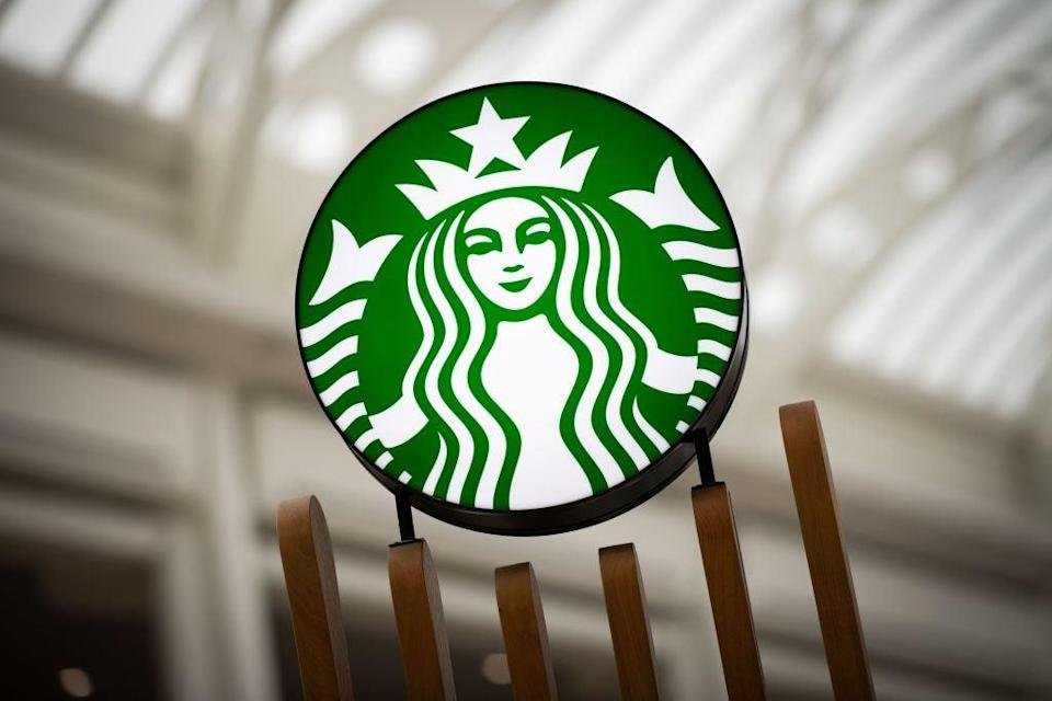 <p>Starbucks employees have been buying other branded items to meet customer demands after nationwide shortages</p> (AFP via Getty Images)