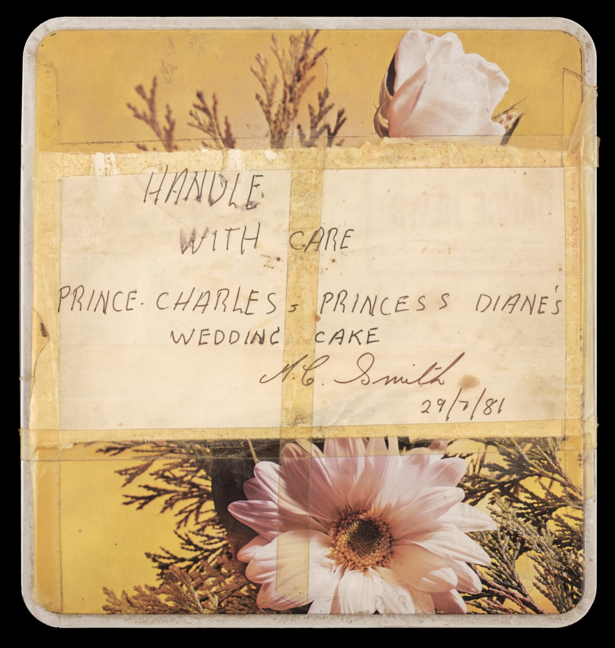 The tin containing the 40-year-old slice of Charles and Diana's wedding cake