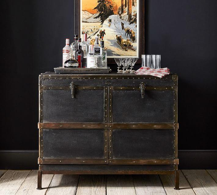 "<p>potterybarn.com</p><p><strong>$1799.00</strong></p><p><a href=""https://go.redirectingat.com?id=74968X1596630&url=https%3A%2F%2Fwww.potterybarn.com%2Fproducts%2Fludlow-trunk-bar-cabinet%2F&sref=https%3A%2F%2Fwww.housebeautiful.com%2Fshopping%2Ffurniture%2Fg33525951%2Fbar-cabinets%2F"" rel=""nofollow noopener"" target=""_blank"" data-ylk=""slk:BUY NOW"" class=""link rapid-noclick-resp"">BUY NOW</a></p><p>This bar cabinet is cleverly made to look like a vintage trunk, for a piece that makes a major statement. It features shelves both in the main part of the cabinet, and in the doors, along with a stemware rack and cubbies for bottles. </p>"