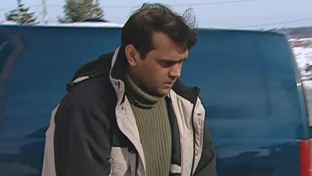 Abdul Bari, pictured here in February 2004, after being charged with first-degree murder in the beating death of his estranged wife, Shaila Akther Bari, 26, is incarcerated at Dorchester Penitentiary. (CBC - image credit)