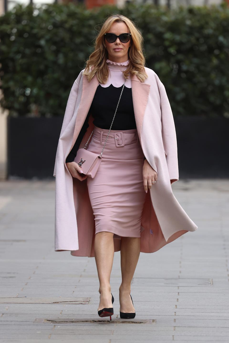 Amanda Holden wears a colour block jumper from John Lewis and an M&S pencil skirt as she leaves Heart Breakfast Radio Studios on 5 May. (Getty Images)