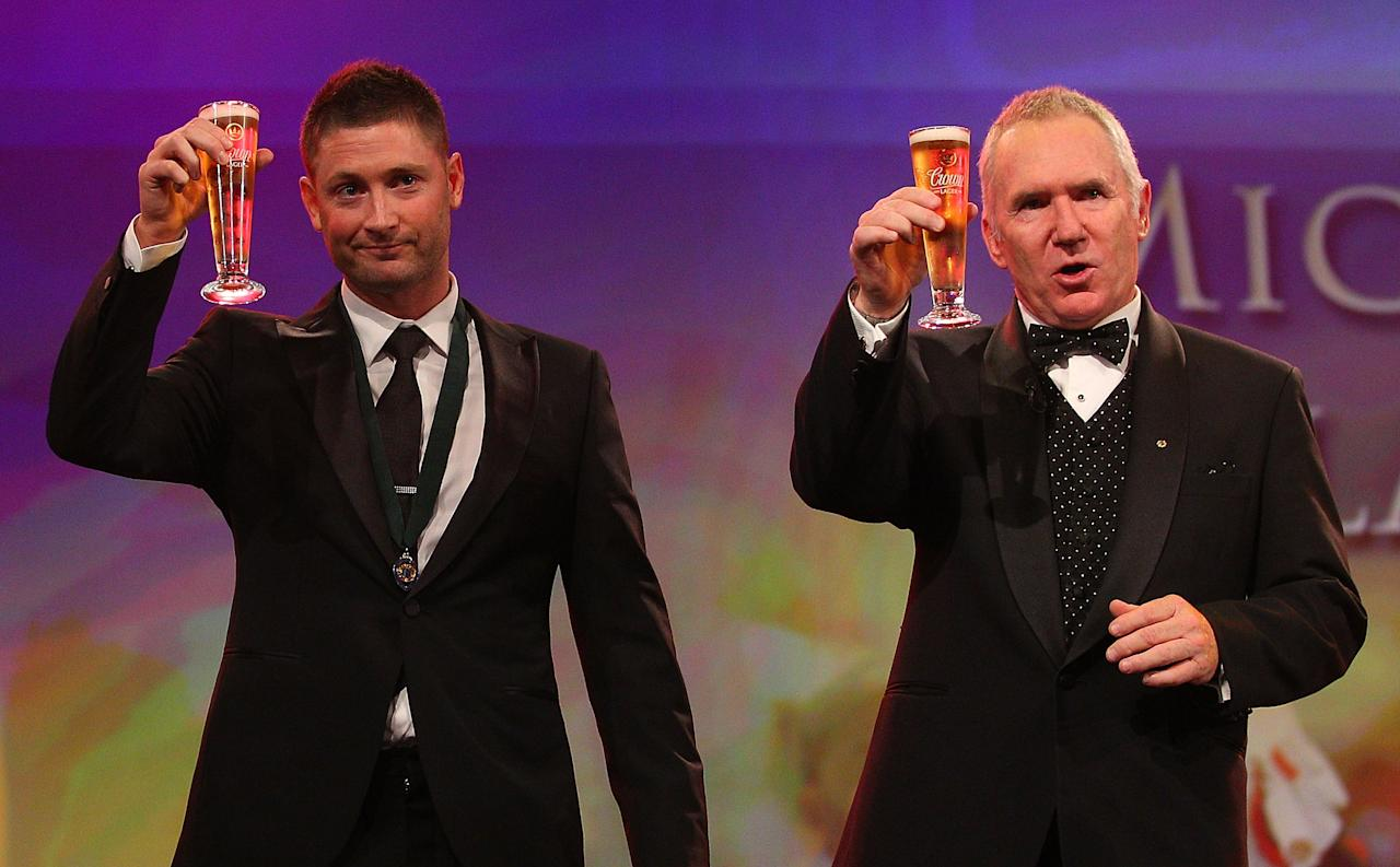 MELBOURNE, AUSTRALIA - FEBRUARY 27:  Michael Clarke (L) of Australia shares a toast with Allan Border after winning the Allan Border Medal during the 2012 Allan Border Medal Awards at Crown Palladium on February 27, 2012 in Melbourne, Australia.  (Photo by Scott Barbour/Getty Images)