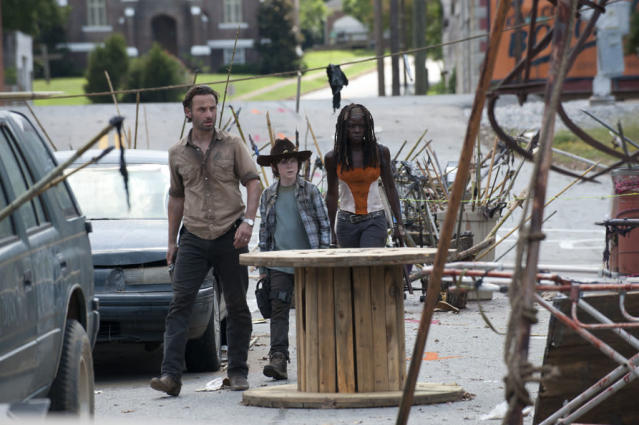 "Rick Grimes (Andrew Lincoln), Carl Grimes (Chandler Riggs) and Michonne (Danai Gurira) in ""The Walking Dead"" episode, ""Clear."""