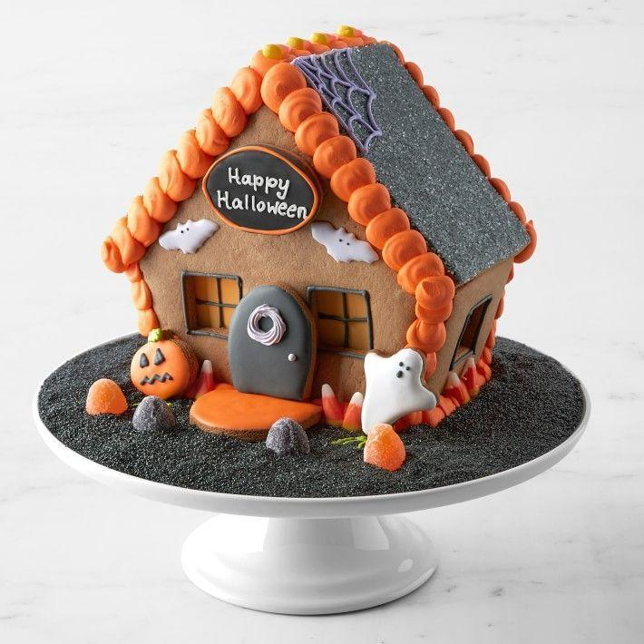 """<p>williams-sonoma.com</p><p><strong>$69.95</strong></p><p><a href=""""https://go.redirectingat.com?id=74968X1596630&url=https%3A%2F%2Fwww.williams-sonoma.com%2Fproducts%2Fhalloween-gingerbread-house&sref=https%3A%2F%2Fwww.thepioneerwoman.com%2Fholidays-celebrations%2Fg37036488%2Fhalloween-gingerbread-house-kits%2F"""" rel=""""nofollow noopener"""" target=""""_blank"""" data-ylk=""""slk:Shop Now"""" class=""""link rapid-noclick-resp"""">Shop Now</a></p><p>For a Halloween gingerbread house that you'll want to display year-round, try this pick from Williams Sonoma that's just gorgeous. Each panel is built using custom molds to give it its unique shape. In addition to cookie ghosts and pumpkins, it also comes with a cookie plaque above the door that you can have customized.</p>"""