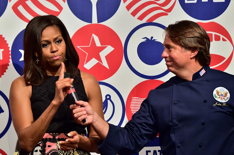 Michelle Obama speaks next to chef John Besh at the James Beard American Restaurant during a visit in Milan on June 17, 2015.  (GIUSEPPE CACACE via Getty Images)