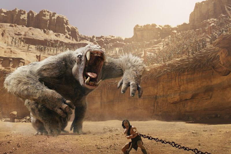 """In this film image released by Disney, Taylor Kitsch is shown in a scene from """"John Carter."""" (AP Photo/Disney)"""