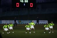 In this photo taken on Saturday, March 28, 2020, a support team dance during a break in the Belarus Championship soccer match between Gorodeya and Shakhter in the town of Gorodeya, Belarus. Longtime Belarus President Alexander Lukashenko is proudly keeping soccer and hockey arenas open even though most sports around the world have shut down because of the coronavirus pandemic. The new coronavirus causes mild or moderate symptoms for most people, but for some, especially older adults and people with existing health problems, it can cause more severe illness or death. (AP Photo/Sergei Grits)