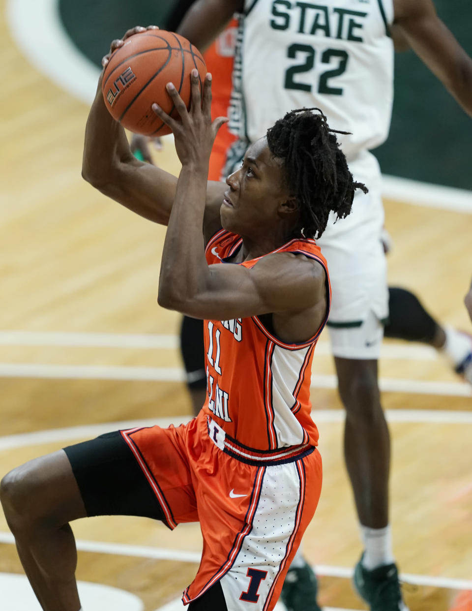 Illinois guard Ayo Dosunmu (11) makes a layup during the first half of an NCAA college basketball game against Michigan State, Tuesday, Feb. 23, 2021, in East Lansing, Mich. (AP Photo/Carlos Osorio)