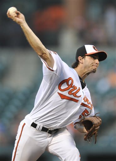 Baltimore Orioles starting pitcher Miguel Gonzalez throws to a Tampa Bay Rays batter in the second inning of a baseball game Wednesday, July 25, 2012, in Baltimore. (AP Photo/Gail Burton)