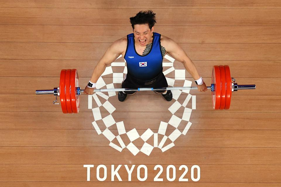 <p>TOKYO, JAPAN - AUGUST 03: Yunseong Jin of Team South Korea competes during the Weightlifting - Men's 109kg Group A on day eleven of the Tokyo 2020 Olympic Games at Tokyo International Forum on August 03, 2021 in Tokyo, Japan. (Photo by Chris Graythen/Getty Images)</p>