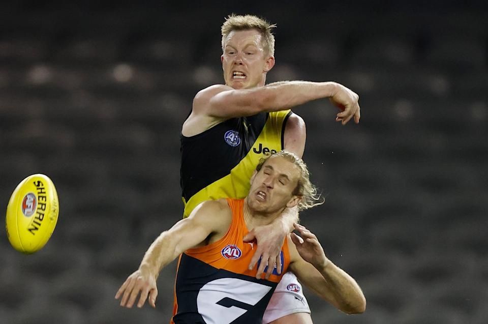 MELBOURNE, AUSTRALIA - AUGUST 13: Jack Riewoldt of the Tigers and Nick Haynes of the Giants in action during the 2021 AFL Round 22 match between the GWS Giants and the Richmond Tigers at Marvel Stadium on August 13, 2021 in Melbourne, Australia. (Photo by Michael Willson/AFL Photos via Getty Images)