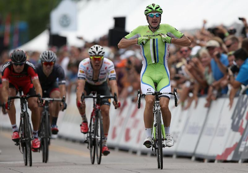 Elia Viviani (R) of Italy riding for Cannondale celebrates his victory in stage four of the 2014 USA Pro Challenge on August 21, 2014 in Colorado Springs, Colorado