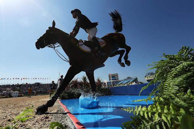 <p>Daniel Bluman of Colombia riding Apardi competes during the Jumping Individual and Team Qualifier on Day 9 of the Rio 2016 Olympic Games at the Olympic Equestrian Centre on August 14, 2016 in Rio de Janeiro, Brazil. (Photo by Christian Petersen/Getty Images) </p>