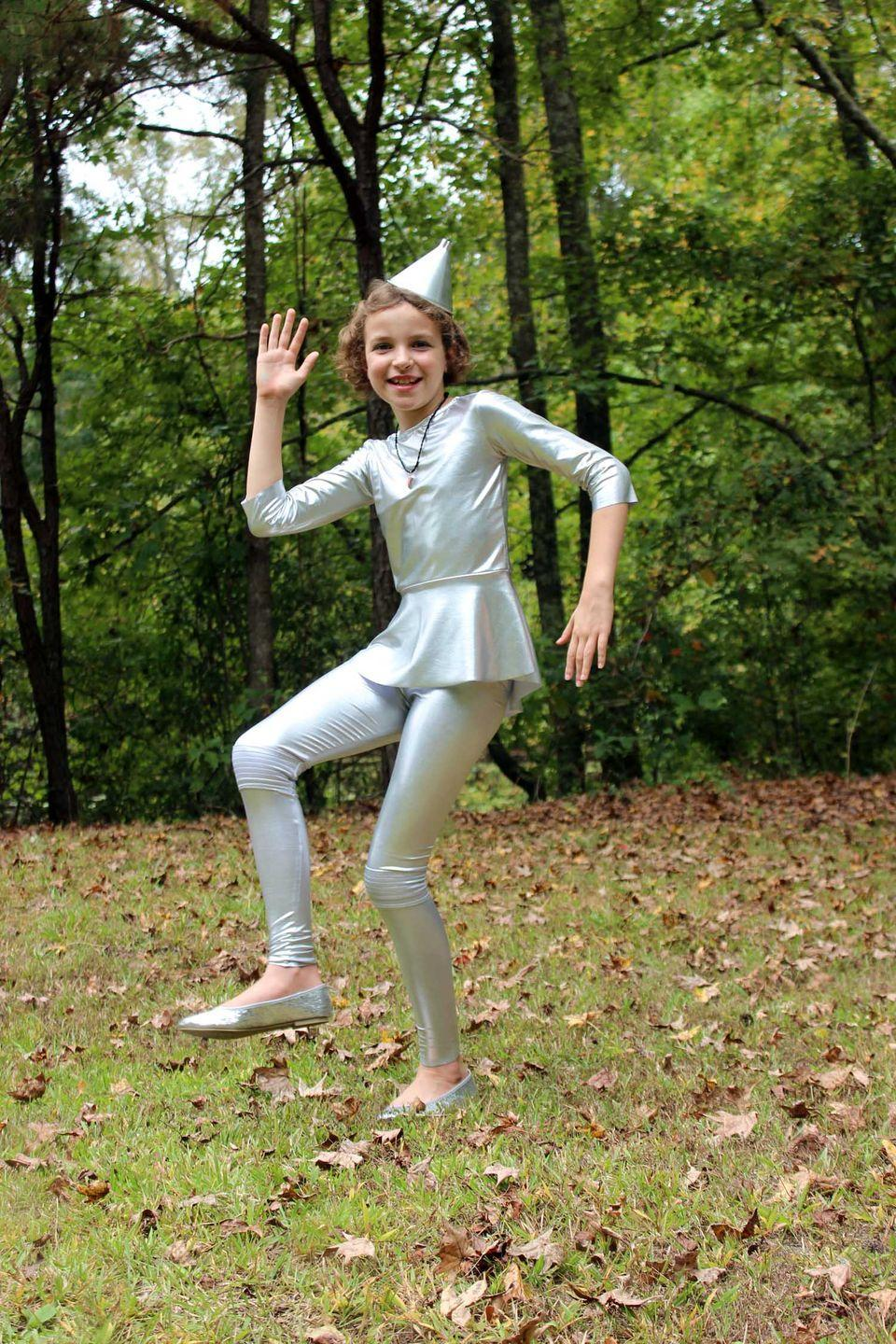 """<p>Though this blogger includes instructions for sewing a <a href=""""https://www.countryliving.com/diy-crafts/g22105023/wizard-of-oz-diy-costumes/"""" rel=""""nofollow noopener"""" target=""""_blank"""" data-ylk=""""slk:Wizard of Oz-inspired costume"""" class=""""link rapid-noclick-resp""""><em>Wizard of Oz</em>-inspired costume</a>, you could also keep it simple with silver clothing and a matching party hat!</p><p><strong>Get the tutorial at <a href=""""https://www.patternrevolution.com/blog/2017/10/9/sew-ready-for-halloween-the-tin-woman-featuring-patterns-from-love-notions-and-jacole"""" rel=""""nofollow noopener"""" target=""""_blank"""" data-ylk=""""slk:Pattern Revolution"""" class=""""link rapid-noclick-resp"""">Pattern Revolution</a>.</strong></p><p><strong><a class=""""link rapid-noclick-resp"""" href=""""https://www.amazon.com/Charades-Wizard-Costume-Shown-X-Large/dp/B088J4ZGJZ/ref=sr_1_2?tag=syn-yahoo-20&ascsubtag=%5Bartid%7C10050.g.23785711%5Bsrc%7Cyahoo-us"""" rel=""""nofollow noopener"""" target=""""_blank"""" data-ylk=""""slk:SHOP TIN MAN COSTUMES"""">SHOP TIN MAN COSTUMES</a></strong></p>"""