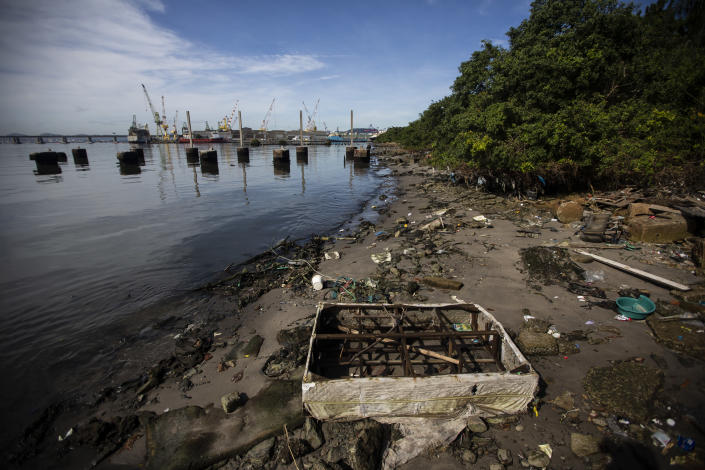 Trash litters the banks of Guanabara Bay, in Rio de Janeiro, Brazil, Thursday, June 24, 2021. Demolition of an elevated highway allowed for sweeping views of the Guanabara Bay where the 2016 Rio de Janeiro Olympics sailing competitions took place, but its waters weren't cleaned of sewage, as had been promised. (AP Photo/Bruna Prado)