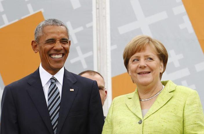 Former President Barack Obama and German Chancellor Angela Merkel attend a discussion at the German Protestant Kirchentag in front of the Brandenburg Gate in Berlin on May 25. (Fabrizio Bensch/Reuters)