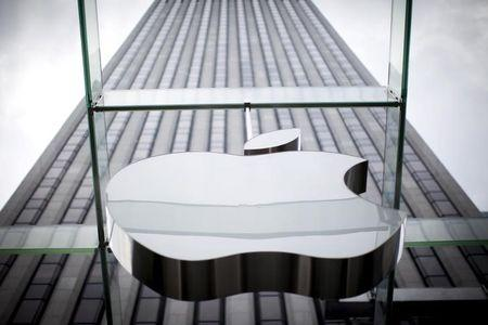 FILE PHOTO: An Apple logo hangs above the entrance to the Apple store on 5th Avenue in the Manhattan borough of New York City, July 21, 2015. REUTERS/Mike Segar