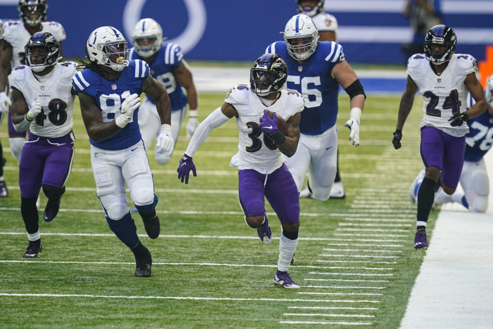 Baltimore Ravens strong safety Chuck Clark (36) heads to the end zone for a touchdown on a fumble recovery against the Indianapolis Colts in the first half of an NFL football game in Indianapolis, Sunday, Nov. 8, 2020. (AP Photo/Darron Cummings)