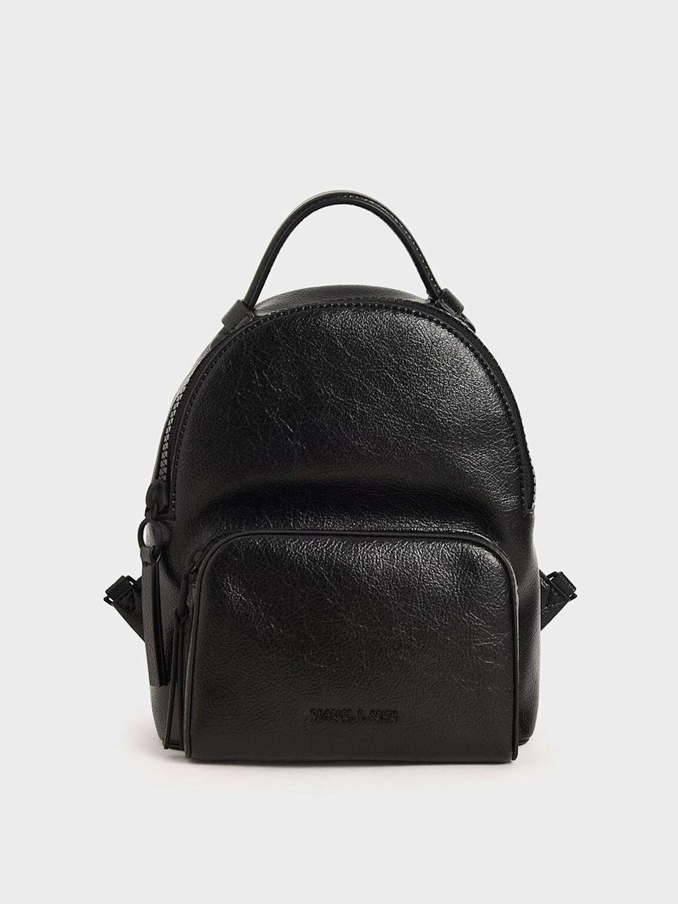 """<p><a class=""""link rapid-noclick-resp"""" href=""""https://go.redirectingat.com?id=127X1599956&url=https%3A%2F%2Fwww.charleskeith.co.uk%2Fgb%2Fbags%2FCK2-60150928_BLACK.html&sref=https%3A%2F%2Fwww.harpersbazaar.com%2Fuk%2Ffashion%2Fg28897412%2Fwork-bags-women%2F"""" rel=""""nofollow noopener"""" target=""""_blank"""" data-ylk=""""slk:SHOP NOW"""">SHOP NOW</a></p><p>No longer reserved for boy scouts and school children, the backpack has gained serious fashion credentials in recent years. Charles & Keith's faux-leather version is detailed with industrial two-way zips and has adjustable straps, as well as a top handle – so you can carry it in-hand on the tube.</p><p>Faux leather backpack, £59, <a href=""""https://go.redirectingat.com?id=127X1599956&url=https%3A%2F%2Fwww.charleskeith.co.uk%2Fgb%2FSL2-10270289.html%3Fdwvar_SL2-10270289_color%3D01&sref=https%3A%2F%2Fwww.harpersbazaar.com%2Fuk%2Ffashion%2Fg28897412%2Fwork-bags-women%2F"""" rel=""""nofollow noopener"""" target=""""_blank"""" data-ylk=""""slk:Charles & Keith"""" class=""""link rapid-noclick-resp"""">Charles & Keith</a></p>"""