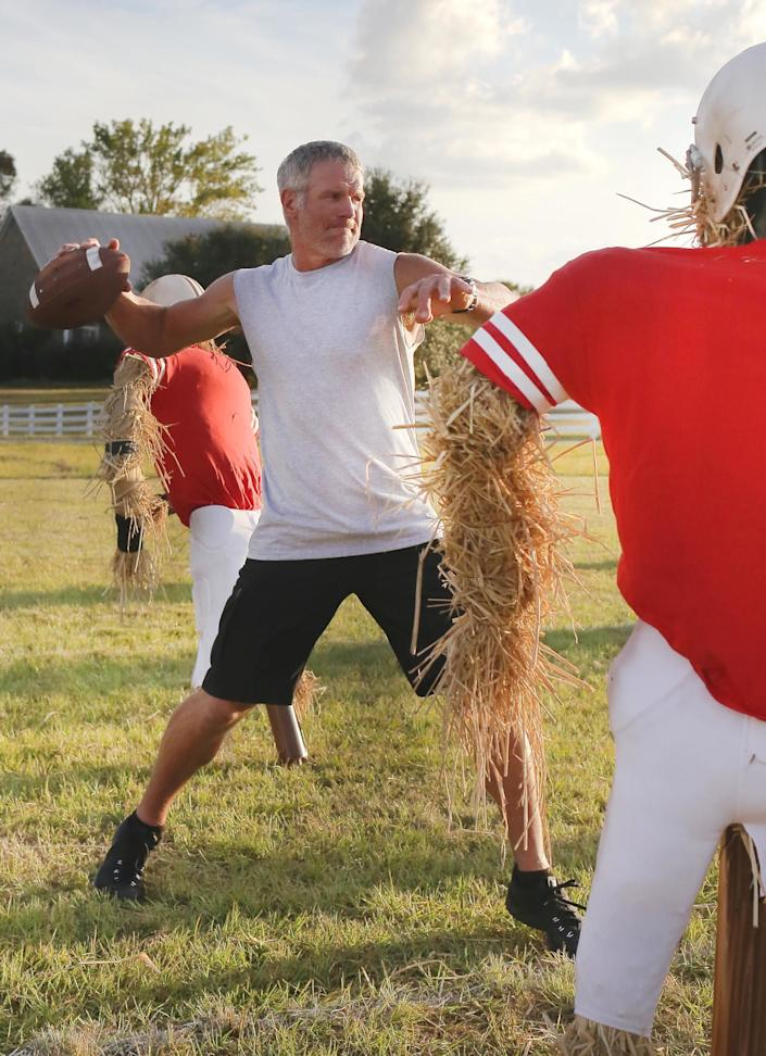 """Hall of Fame QB Brett Favre warms up while filming Buffalo Wild Wings' new """"What the Favre?!"""" TV commercial."""