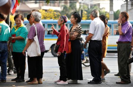 People queue to cast their vote in the general election at a polling station in Bangkok, Thailand, March 24, 2019. REUTERS/Soe Zeya Tun