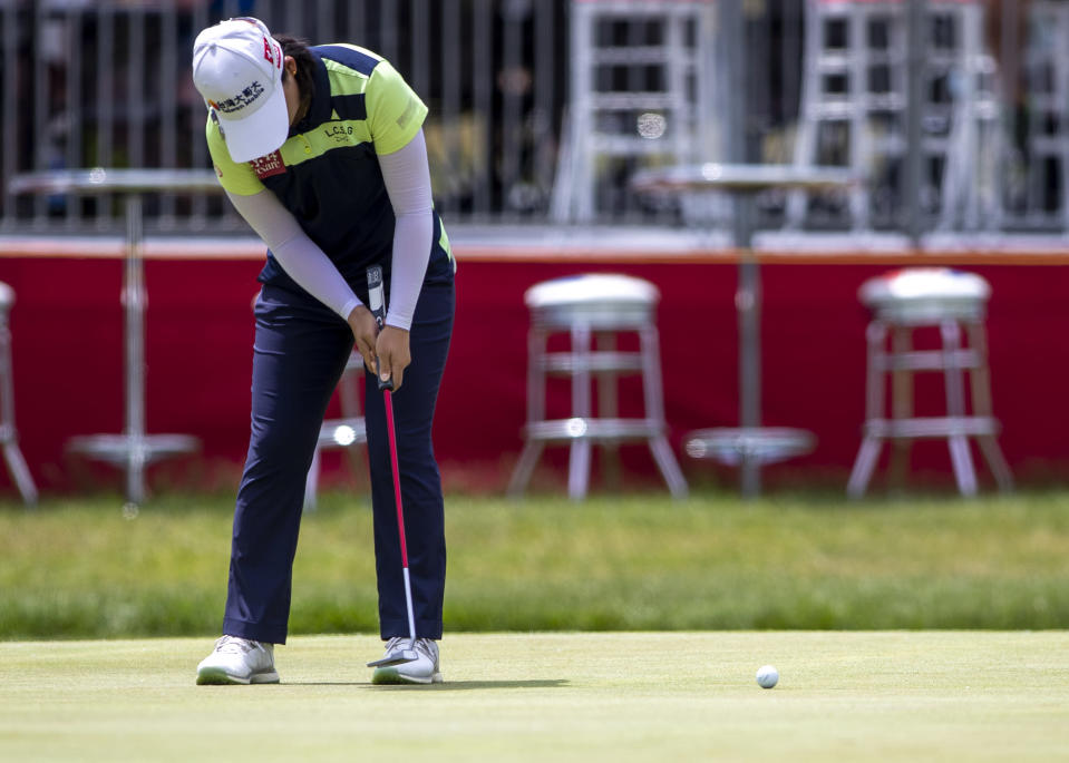 Min Lee putts on the 18th hole during the first round of the Meijer LPGA Classic golf tournament at the Blythefield Country Club in Belmont, Mich., Thursday, June 17, 2021. (Cory Morse/The Grand Rapids Press via AP)