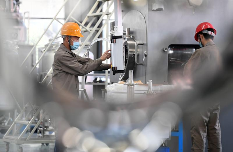 YICHUN, Feb. 24, 2020 -- Workers work on a production line to produce dry granulators, which will be supplied to drug manufacturers in Shanghai and other cities to help combat the novel coronavirus, at Wanshen Pharmaceutical Machinery Co., Ltd. in Yichun, east China's Jiangxi Province, Feb. 24, 2020. The government of Yichun has coordinated with the company to ensure the production at full capacity amid epidemic prevention and control efforts. (Photo by Zhou Liang/Xinhua via Getty) (Xinhua/Zhou Mi via Getty Images)