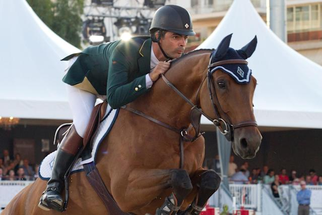 CANNES, FRANCE - JUNE 16: Rodrigo Pessoa competes in the the '31st International Cannes Jumping' - Global Champions Tour 2012 on June 16, 2012 in Cannes, France. (Photo by Marc Piasecki/Getty Images)