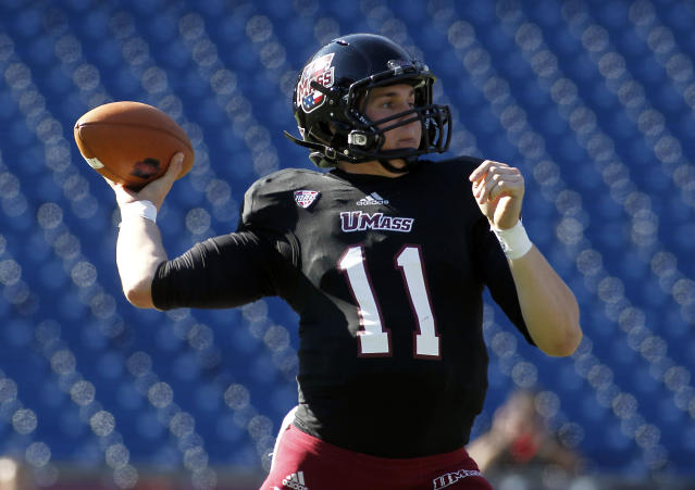 Massachusetts quarterback Mike Wegzyn (11) passes the ball against Northern Illinois during the first half of an NCAA football game in Foxborough, Mass., Saturday, Nov. 2, 2013. (AP Photo/Stew Milne)