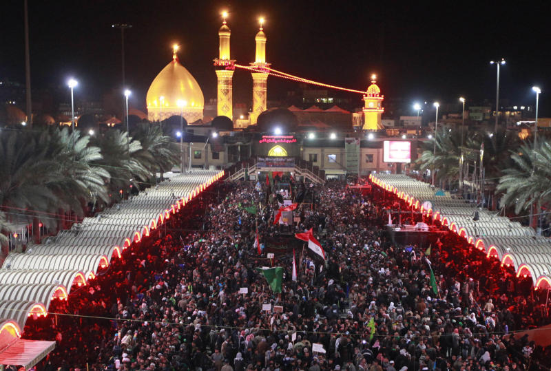 Shiite Muslim worshippers gather in front of the holy shrine of Imam Abbas, seen in the background, to mark the Muslim festival of Arbaeen in Karbala, 50 miles (80 kilometers) south of Baghdad, Iraq, Wednesday, Jan. 2 , 2013. The holiday marks the end of the forty day mourning period after the anniversary of the 7th century martyrdom of Imam Hussein the Prophet Muhammad's grandson. (AP Photo/Hadi Mizban)