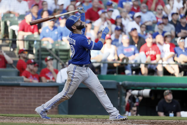 Toronto Blue Jays right fielder Jose Bautista (19) flies out against the Texas Rangers during the sixth inning in Game 4 of baseball's American League Division Series Monday, Oct. 12, 2015, in Arlington, Texas. (AP Photo/Tony Gutierrez)