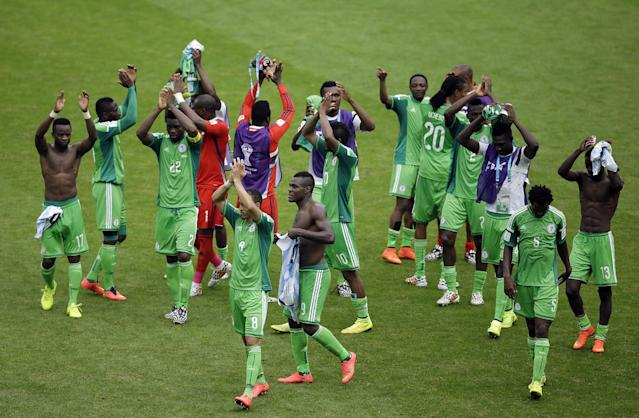 Nigeria waves to supporters after being defeated by Argentina, 3-2, during the group F World Cup soccer match between Nigeria and Argentina at the Estadio Beira-Rio in Porto Alegre, Brazil, Wednesday, June 25, 2014. (AP Photo/Michael Sohn)