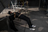 """Street performer Kenneth Pomponio, 23, exercises in a Batman costume while working on the Hollywood Walk of Fame in Los Angeles, Wednesday, Oct. 21, 2020. Pomponio said he is voting for Democratic presidential candidate former Vice President Joe Biden. """"I just think that the whole political system needs some reform,"""" said Pomponio. """"I think that the Republicans are too influenced by lobbyists and too prejudiced against other cultures so I think it's time for change."""" (AP Photo/Jae C. Hong)"""