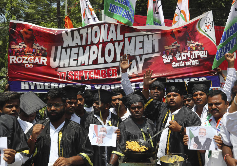 Indian Youth Congress activists shout slogans during a protest marking Indian Prime Minister Narendra Modi's birthday in Hyderabad, India, Friday, Sept. 17, 2021. (AP Photo/Mahesh Kumar A.)