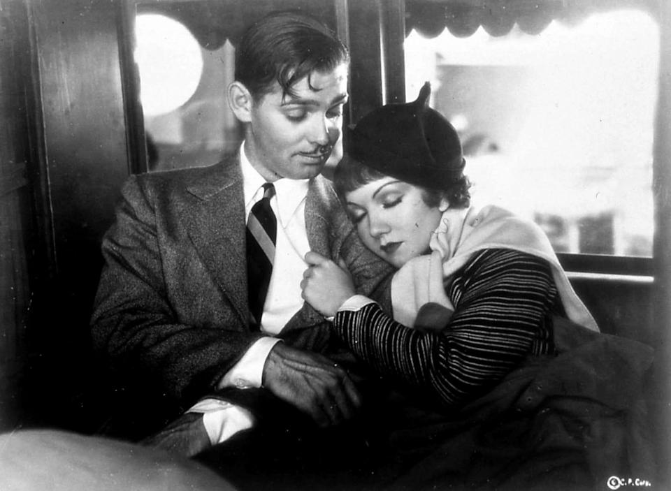 "Clark Gable's out-of-work journalist and Claudette Colbert's runaway heiress meet cute in the Frank Capra romantic comedy ""It Happened One Night."""