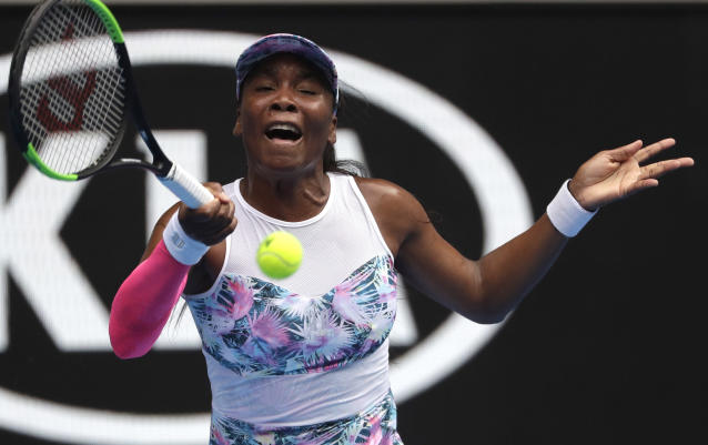 United States' Venus Williams makes a forehand return to Romania's Mihaela Buzarnescu during their first round match at the Australian Open tennis championships in Melbourne, Australia, Tuesday, Jan. 15, 2019. (AP Photo/Mark Schiefelbein)
