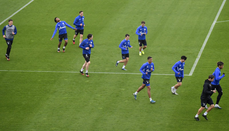 US national player Weston McKennie, second from left, exercises with his Bundesliga team of soccer club FC Schalke 04 during a training session in Gelsenkirchen, Germany, Wednesday, April 29, 2020. Despite a ban in Germany on all large gatherings through the end of August to fight the coronavirus pandemic, soccer officials are hoping to restart the league without spectators in May. (AP Photo/Martin Meissner)